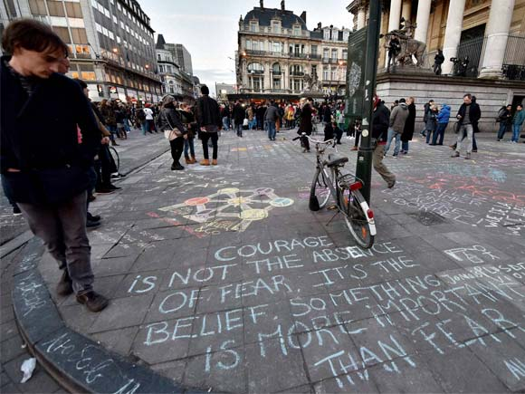 brussells people write hundreds of messages on the asphalt at place de la bourse in the center of brussels to mourn for the victims of bomb attack