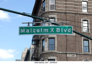 Street sign of the Malcolm X Blvd in East Harlem in New York City